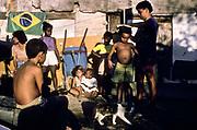 Children being measured in their slum by a social worker, Rio de Janeiro, Brazil.