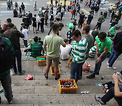 27 September 2017 Brussels: Celtic supporters in the city centre before the Champions League match against Anderlecht: the steps of the Stock Exchange (La Bourse) are full of crates of beer and fans: Photo: Mark Leech