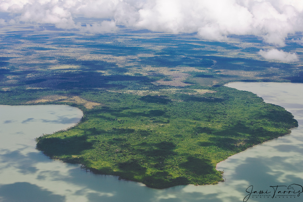 Aerial of cloud shadows on lake, Amazon rain forest, Eastern Lowlands,  Bolivia