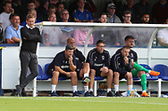 AFC Wimbledon manager Neal Ardley looking on during the EFL Sky Bet League 1 match between AFC Wimbledon and Scunthorpe United at the Cherry Red Records Stadium, Kingston, England on 15 September 2018.