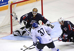 Mika Pyorala of Finland, goalkeeper of USA Robert Esche and Tom Gilbert (77) of USA at ice-hockey match Finland vs USA at Qualifying round Group F of IIHF WC 2008 in Halifax, on May 11, 2008 in Metro Center, Halifax, Nova Scotia, Canada. (Photo by Vid Ponikvar / Sportal Images)