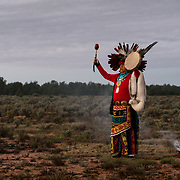 Uqualla, a Havasupai medicine man, faces the rising sun during a morning prayer, October 6, 2018, at Havasupai Tribe's Intertribal Spiritual Gathering at Red Butte.