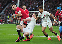 Rugby Union - 2020 Guinness Six Nations Championship - England vs. Wales<br /> <br /> George North of Wales is tackled by Owen Farrell with Anthony Watson (right), at Twickenham.<br /> <br /> COLORSPORT/ANDREW COWIE