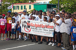 James and Celia Carroll, center, line up at the starting line.  Virgin Islanders gear up for the 2-mile Virgin Islands Walk/Run Against Gun Violence along the Charlotte Amalie Waterfront.   Proceeds from the event go to benefit the Jason Carroll Memorial Fund for college scholarships.  St. Thomas, VI.  22 May 2016.  © Aisha-Zakiya Boyd