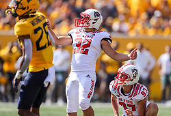 Sep 14, 2019; Morgantown, WV, USA; North Carolina State Wolfpack place kicker Christopher Dunn (32) kicks a field goal during the third quarter against the West Virginia Mountaineers at Mountaineer Field at Milan Puskar Stadium. Mandatory Credit: Ben Queen-USA TODAY Sports