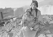 9305-B7362-3.  Agnes Thompson (wife of Henry Thompson) and daughter Louise Thompson at Celilo Falls. September 1938.