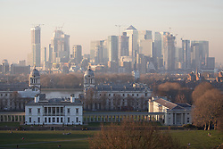 © Licensed to London News Pictures. 26/02/2019. London, UK. General view of Greenwich Park and Canary Wharf in London at sunset last night, following days of unseasonably warm weather in the capital. Temperatures on Tuesday 26 February reached 20.8C in Porthmadog, north-west Wales, which was the warmest winter day on record. Sadiq Khan, the Mayor of London, has announced a high alert for air pollution in the capital. Photo credit : Tom Nicholson/LNP