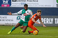 Plymouth Argyle defender Yann Songo'o (4) brings down Luton Town forward James Collins (19)  during the EFL Sky Bet League 1 match between Luton Town and Plymouth Argyle at Kenilworth Road, Luton, England on 17 November 2018.