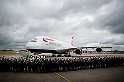 © London News Pictures. 04/07/2013 . London, UK.  British Airways staff wave union flags as the new British Airways Boeing A380 superjumbo arrives at Heathrow Airport. It was the first time British Airlines have taken delivery of the new plane, making British Airways the first European airline to operate both the 787 and A380. Photo credit : Ben Cawthra/LNP