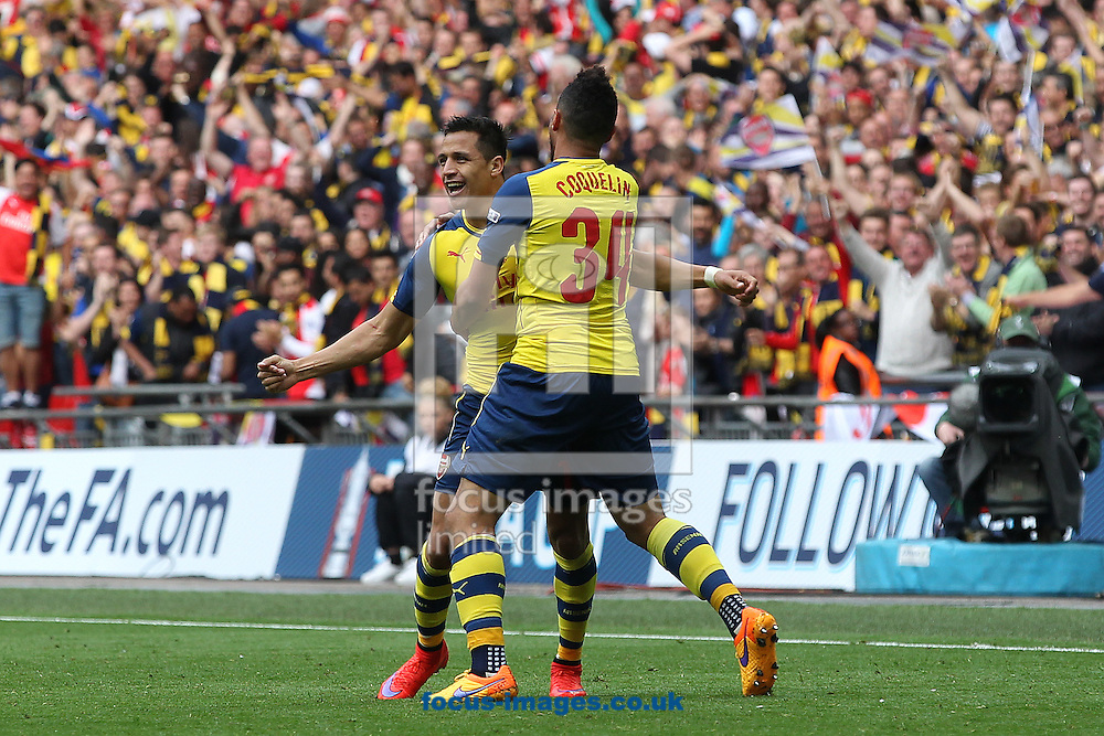 Alexis Sánchez of Arsenal celebrates scoring his sides 2nd goall during the FA Cup Final at Wembley Stadium, London<br /> Picture by Paul Chesterton/Focus Images Ltd +44 7904 640267<br /> 30/05/2015