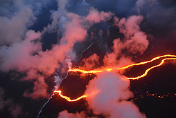 Handout photo of KÄ«lauea Volcano — Lava Channels Entering Sea. On May 23, 2018, the Hilo Civil Air Patrol captured this evening photograph of the coastline where lava flows are entering the sea. There are currently three primary ocean entry points, which have evolved over the course of the eruption. Photo by USGS via ABACAPRESS.COM