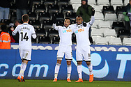 Jordan Ayew of Swansea city ® celebrates with teammate Martin Olsson after he scores his teams 1st goal. The Emirates FA Cup, 5th round replay match, Swansea city v Sheffield Wednesday at the Liberty Stadium in Swansea, South Wales on Tuesday 27th February 2018.<br /> pic by  Andrew Orchard, Andrew Orchard sports photography.