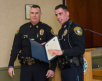 Gilford Police Chief Anthony Bean Burpee presents Officer Curtis Mailloux with a medal for lifesaving with valor for his heroic actions entering the smoke filled home of Jim and Pat Gray on the evening of Sunday, February 8th.   (Karen Bobotas/for the Laconia Daily Sun)