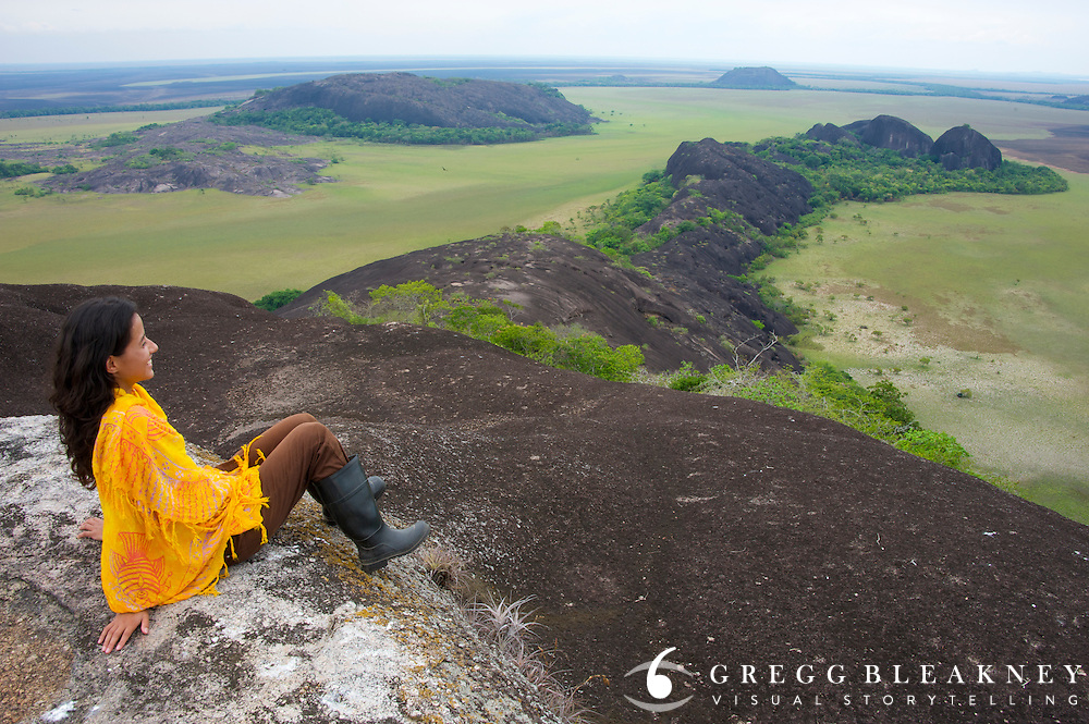 An ecologist from Bogota takes in the view (dry season) from the top of a Tepuy mesa in the Llanos plains, home of the oldest rock formations in the world - Colombia - South America