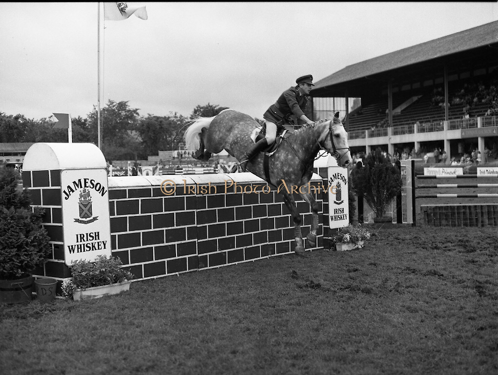 Jameson Whiskey International at the Dublin Horse Show.  (R39).1986..07.08.1986..08.07.1986..7th August 1986..The Jameson Whiskey International at the Dublin Horse Show in the RDS was won by Peter Charles of Great Britain. He rode 'Merrimandias' to victory in the event...Image shows Capt Gerry Mullins in the Jameson Whiskey International clearing the wall aboard his mount 'Glendalough' at the Horse Show. Jameson's, Irish, Whiskey, jameson,