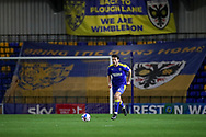 AFC Wimbledon defender Will Nightingale (5) dribbling in front of back to Plough Lane and Bring the Dons Home signs during the EFL Sky Bet League 1 match between AFC Wimbledon and Gillingham at Plough Lane, London, United Kingdom on 23 February 2021.