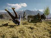 Boys doing summersaults. Threshing wheat with donkeys. In Roshorv village.