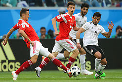 June 19, 2018 - Saint Petersburg, Russia - Denis Cheryshev (L), Aleksandr Golovin of the Russia national football team and Tarek Hamed of the Egypt national football team vie for the ball during the 2018 FIFA World Cup match, first stage - Group A between Russia and Egypt at Saint Petersburg Stadium on June 19, 2018 in St. Petersburg, Russia. (Credit Image: © Igor Russak/NurPhoto via ZUMA Press)
