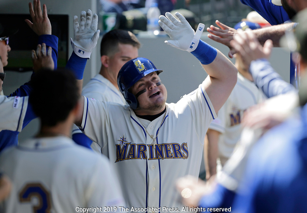 Seattle Mariners' Daniel Vogelbach in the dugout after hitting a solo home run on a pitch from Minnesota Twins' Kyle Gibson during the fifth inning of a baseball game, Sunday, May 19, 2019, in Seattle. (AP Photo/John Froschauer)