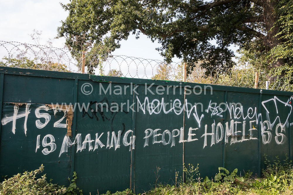 Graffiti reading 'HS2 Is Making People Homeless' sprayed on boards around a construction site for the HS2 high-speed rail link in the Colne Valley is pictured on 11 September 2020 in Denham Green, United Kingdom. Anti-HS2 activists continue to try to prevent or delay works on the controversial £106bn HS2 high-speed rail link from a series of protection camps based along the route of the line between London and Birmingham.