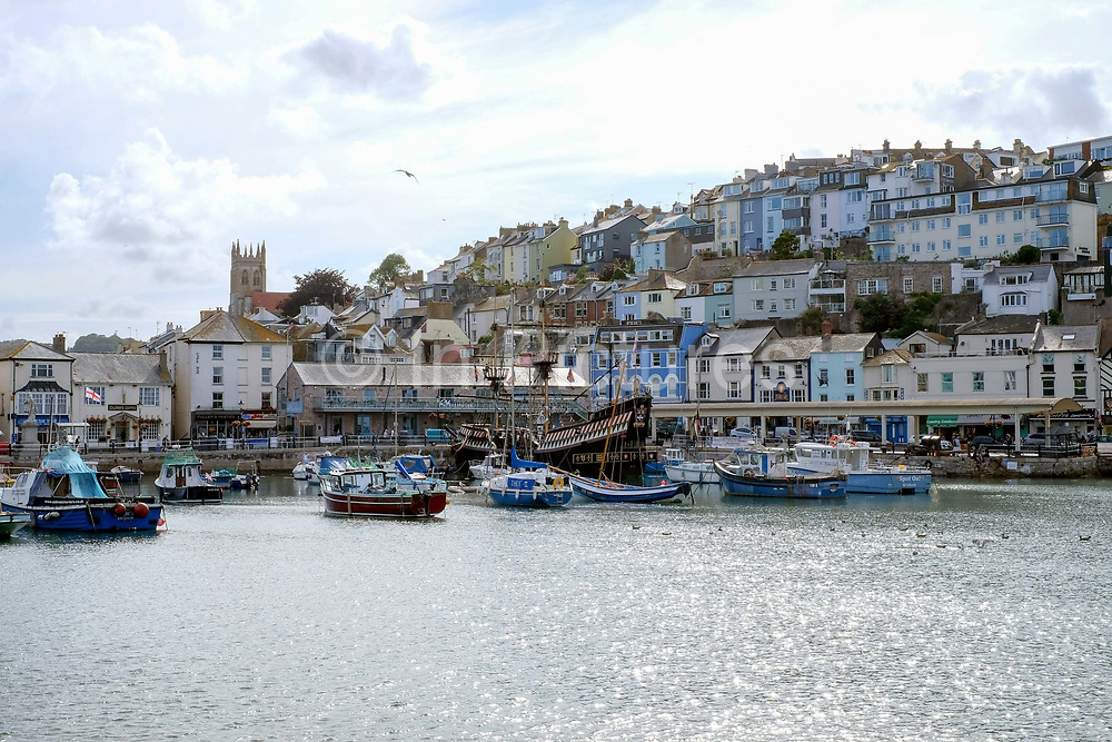 Brixham harbour on 25 July 2017 in Devon, United Kingdom. Brixham is a small fishing town in the English Riviera in south Devon