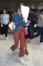 Hailey Baldwin arrives at Nice airport and walks through the terminal with a jumper over her face<br /><br />10 May 2018.<br /><br />Please byline: Vantagenews.com