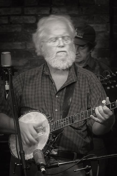 Harry Bickel playing the old time banjo at the Rudyard Kipling in Louisville, Kentucky.