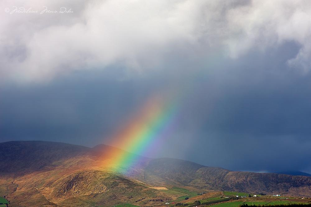 Powerful Rainbow over Hills of Ballinskelligs after rain shower County Kerry, Ireland. Irish Weather Magic / rb001