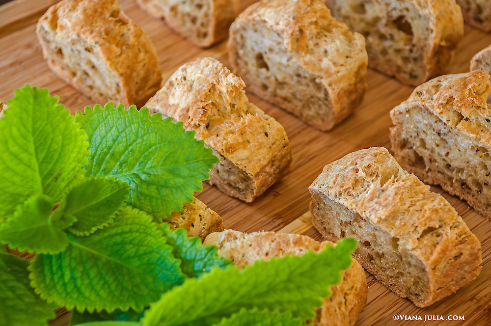 Bread Loaves Sliced with fresh oregano garnish