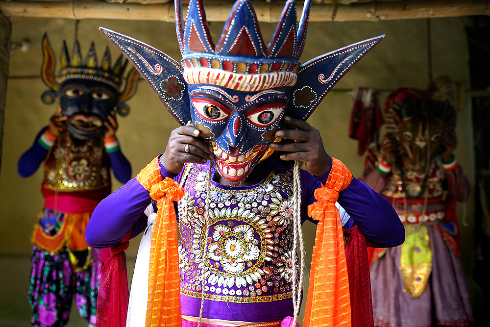 """The exact origin of the dance form is not traceable as it's lost in the realms of time. Another section believes that the word """"Gomira"""" has been derived from the word 'Gamar', the wood that is mainly used to make the masks. The Gomira dance is also part of the ritualistic dance forms that prays the Adi-Shakti or the primordial energy. Thus Gomira also celebrates Shaktism or worships Lord Shiva just like other dance forms like Gajan and Neel puja .<br /> <br /> The festival is celebrated mostly at the end of Bengali year . Gomira is actually an animistic tradition in which the primitive people pay their homage to different Gods in order to attain security. The Gomira dance have extensive .The festival is celebrated mostly at the end of Bengali year by use of wooden masks. The artists wear various masks which depicts various incarnations of Kali, Nrisingha and ghosts.<br /> <br /> Though Gomira is celebrated in jalpaiguri and Dinajpur, it's originated from Malda. Traditionally the Gomira starts four days priour to the end of Chaitra and ends in the first day of Baisakh. However the tradition is not followed strictly now a days and it starts on the last day of chaitra at Kushmandi. The wooden masks are the symbol of the richness of the craftsmanship of the local people. Masks of various forms of kali,the rakshashas(deamons) animals are used. Nrisingha masks are very common."""