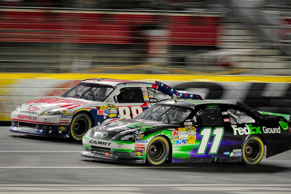 May 24, 2012; Concord, NC USA; NASCAR Sprint Cup Series driver Denny Hamlin (11) and Dale Earnhardt Jr. (88) during the Coca-Cola 600 at Charlotte Motor Speedway. Photo by Kevin Liles/kevindliles.com