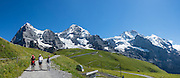 """Walk downhill from Eigergletscher train station (of the Jungfraujoch """"Top of Europe"""" railway) under the north face of the Eiger (3970m / 13,020 ft elevation) to Alpiglen station in Grindelwald Valley, Canton of Bern, Switzerland, the Alps, Europe. The Eiger has the biggest north face in the Alps: 1800 vertical meters (or 5900 ft) of rock and ice. The Swiss Alps Jungfrau-Aletsch region is honored as a UNESCO World Heritage Site.The Swiss Alps Jungfrau-Aletsch region is honored as a UNESCO World Heritage Site. This image was stitched from multiple overlapping photos. For licensing options, please inquire."""