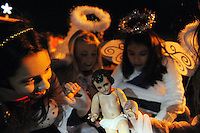 Girls from Sacred Heart prepare their Nativity float before the parade on Sunday evening. Thousands of Salinas residents turned out to experience the magic of the 14th annual Holiday Parade of Lights in Oldtown Salinas.