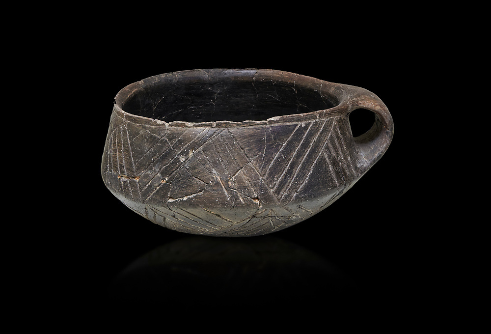 Neolithic Cretian clay single handled cup open kiln fired at Knossos,  4500-3000 BC, Heraklion Archaeological  Museum, black background. .<br /> <br /> If you prefer to buy from our ALAMY PHOTO LIBRARY  Collection visit : https://www.alamy.com/portfolio/paul-williams-funkystock/minoan-art-artefacts.html . Type -   Heraklion   - into the LOWER SEARCH WITHIN GALLERY box. Refine search by adding background colour, place, museum etc<br /> <br /> Visit our MINOAN ART PHOTO COLLECTIONS for more photos to download  as wall art prints https://funkystock.photoshelter.com/gallery-collection/Ancient-Minoans-Art-Artefacts-Antiquities-Historic-Places-Pictures-Images-of/C0000ricT2SU_M9w