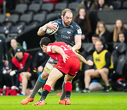 Alun Wyn Jones of Ospreys under pressure from Alex Lozowski of Saracens<br /> <br /> Photographer Simon King/Replay Images<br /> <br /> European Rugby Champions Cup Round 5 - Ospreys v Saracens - Saturday 11th January 2020 - Liberty Stadium - Swansea<br /> <br /> World Copyright © Replay Images . All rights reserved. info@replayimages.co.uk - http://replayimages.co.uk