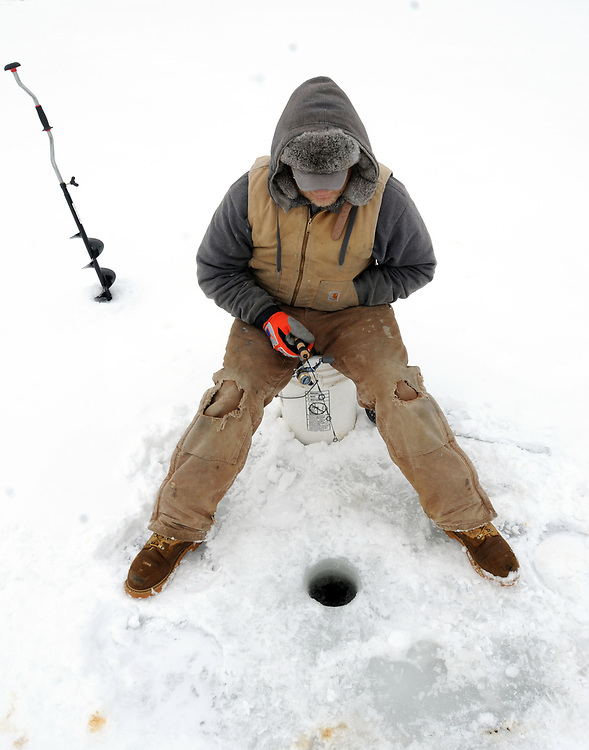 Because of the snow David Wright of Killingworth got a day off from his construction job as a sider and headed off to Messerschmidt's Pond in Westbrook for a spot of ice fishing for bass. Photo by Mara Lavitt/New Haven Register<br /> <br /> 2/21/11