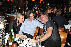 Left to right, CAPRICE BOURRET, TY COMFORT and ROBERT TCHENGUIZ at a dinner hosted by de Grisogono at 17 Berkeley Street, London on 12th November 2012.