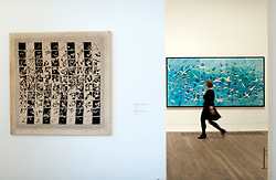 © Licensed to London News Pictures. 27/02/2012. London, UK. A gallery worker walks past a piece of tapestry artwork titled 'Aeroplanes 1989' (right) and 'Alternating from one to omen Hundred and Vice Versa 1977 - 1978' (left) by artist Alighiero Boetti at a photocall for the opening of Alighiero Boetti: Game Plan exhibition at the Tate Modern art gallery in London on February 27th, 2012. Photo credit : Ben Cawthra/LNP
