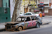 The burnt-out wreck of a car on a street corner in upmarket Buenos Aires neighborhood Palermo Hollywood.