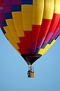 'Wicked' rises into a cloudless blue sky, Crown of Maine Balloon Fair, Presque Isle, Maine.