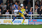 AFC Wimbledon defender & captain Barry Fuller (2) and Rochdale FC midfielder Nathaniel Mendez-Laing (11) tussles during the EFL Sky Bet League 1 match between Rochdale and AFC Wimbledon at Spotland, Rochdale, England on 27 August 2016. Photo by Stuart Butcher.
