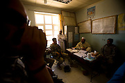 Soldiers of the 3rd platoon of the 10th mountain division talk to locals during a patrol in Logar province, Afghanistan on Tuesday, May 12th 2009...Photo: Guilad Kahn..LT Davis and his soldiers visit the local clinic to assess their needs.