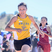 Valley Sanders Pirate Nizhoni Jams crosses the finish line in third place during the girls varsity race at the Zuni Invitational cross country meet in Zuni Saturday.