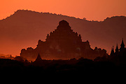 Dhammayangyi Temple from Winido Temple view at sunset with mountains, Bagan, Myanmar
