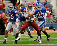 October 10, 2009:  Running back Alexander Robinson #33 of the Iowa State Cyclones rushes up field for a 22-yard gain against pressure from defenders Darrell Stuckey #25, Ryan Murphy #23 and Justin Thornton #46 of the Kansas Jayhawks in the third quarter at Memorial Stadium in Lawrence, Kansas.  Kansas defeated the Cyclones 41-36.