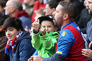 a Young Crystal Palace supporter is seen gesturing to the Norwich City fans. Barclays Premier League match, Crystal Palace v Norwich city at Selhurst Park in London on Saturday 9th April 2016. pic by John Patrick Fletcher, Andrew Orchard sports photography.