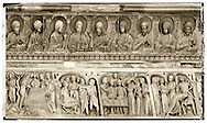 Bas relief feeze above the door of the Baptistry of Pisa Duomo, Italy . The Pisa Baptistery of St. John is a Roman Catholic ecclesiastical building in Pisa, Italy. Construction started in 1152 to replace an older baptistery, and when it was completed in 1363, it became the second building, in chronological order, in the Piazza dei Miracoli, near the Duomo di Pisa . The largest baptistery in Italy, it is 54.86 m high, with a diameter of 34.13 m. The Pisa Baptistery is an example of the transition from the Romanesque style to the Gothic style: the lower section is in the Romanesque style, with rounded arches, while the upper sections are in the Gothic style, with pointed arches. The Baptistery is constructed of marble, as is common in Italian architecture.