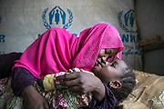 Fadimatu, 24, kisses her three-year-old daughter, Aisha, in her home in an IDP camp, Maiduguri, Nigeria, April 21, 2019. On August 2014, while she was admitted to a college, she was abducted by a Boko Haram fighter and was raped by four fighters on arrival at Sambisa Forest. She was pregnant by one of the offenders and stayed in the forest for two and half years before being rescued by the Nigerian Army. Now living in the IDP camp, she started her own small business of making fruit juice and travelled overseas to give out testimonies.