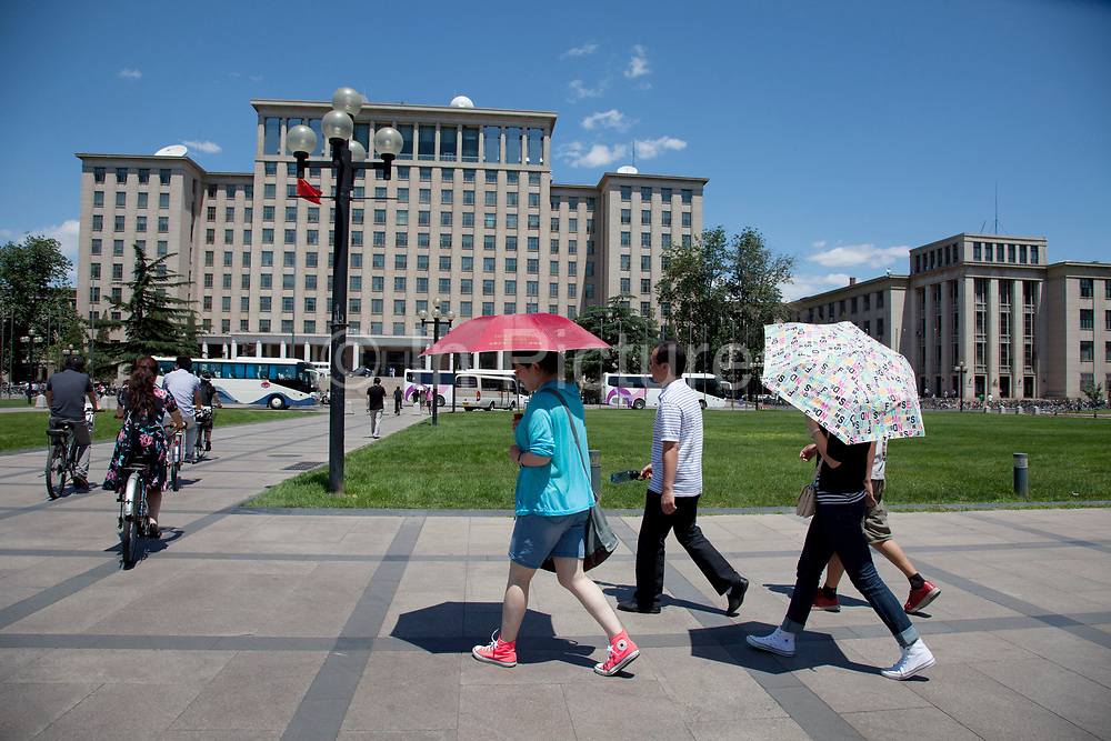 Students walk past the central main building on campus at Tsinghua University in Beijing, China. The school is one of the nine universities of the C9 League. It was established in 1911 under the name 'Tsinghua Xuetang'. The university section was founded in 1925 and the name 'National Tsinghua University' started in 1928. With a motto of Self-Discipline and Social Commitment, Tsinghua University describes itself as being dedicated to academic excellence, the well-being of Chinese society and to global development. Tsinghua is almost always ranked as the first or second best university in mainland China in many national and international rankings. According to the Times Higher Education World University Rankings 2011–2012, Tsinghua ranked 71 worldwide among universities.