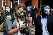 London, UK. Thursday 16th August 2012. Supporters of Julian Assange from Anonymous UK wearing masks outside the Ecuador Embassy.